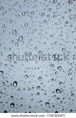 Water droplets on gray glass