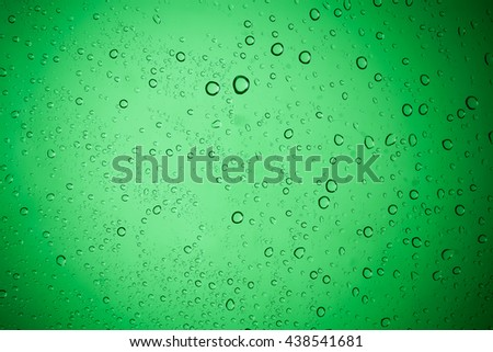 Water droplets on green glass for a background. - stock photo