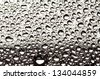 Water droplets on metal surface - stock photo