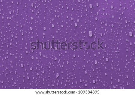 Water Droplets on Pink metallic Surface - stock photo