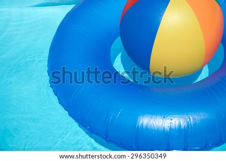 Pool Water With Beach Ball yellow white beach ball swimming pool stock photo 16044964