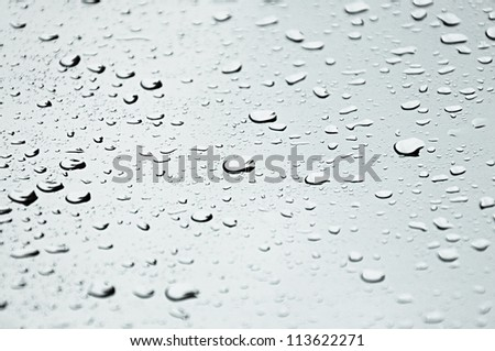 Water droplets on the glass - stock photo