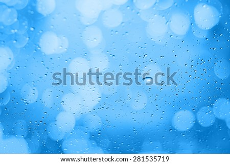 Water droplets on the glass with a colored background. Drips of water. - stock photo