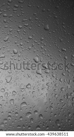 Water droplets on the surface of gray, black.