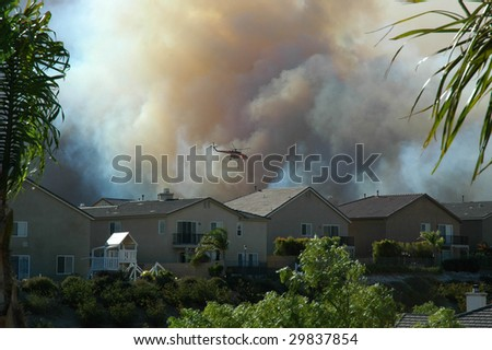 Water dropping helicopter, California wildfire - stock photo