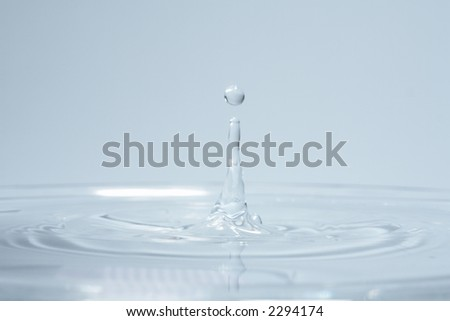 Water dropplett over blue background - stock photo