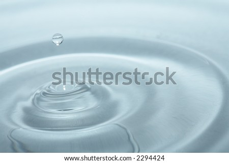 Water droppletts over blue background - stock photo