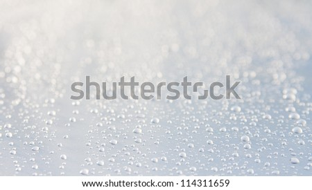water drops an metallik background with blur - stock photo