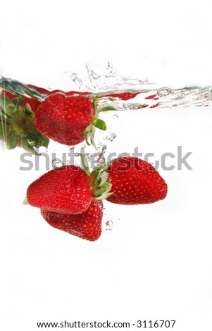 water drops and strawberries in water - stock photo
