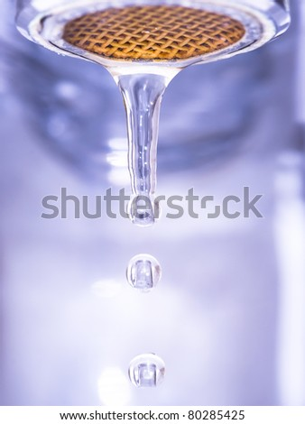water drops and water pipe - stock photo