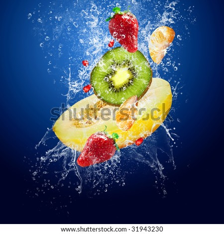 Water drops around fruits on blue background - stock photo