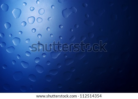 Water drops blue abstract background