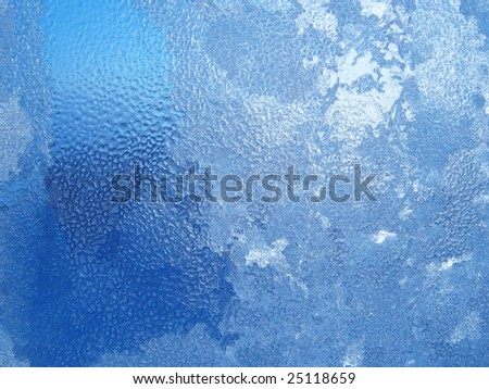 water drops end frost on window - stock photo