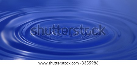 water drops enters into the blue water