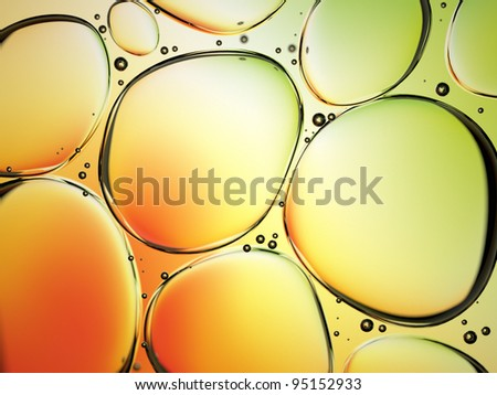 water drops in oil on colorful background - stock photo