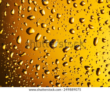 Water drops on a beer glass. Closeup.
