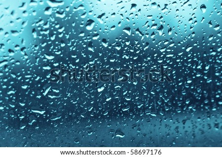 water drops on a glass in avto in rain - stock photo