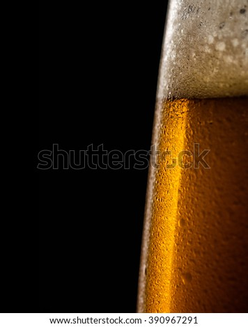 Water drops on a glass of beer. Macro shot. Shallow depth of field. Copyspace on left.