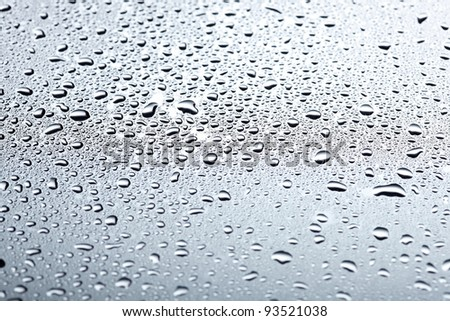 Water drops on a light shiny surface - stock photo