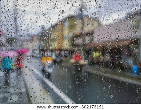 Water drops on a window glass after the rain. View of Buildings in the city. - stock photo