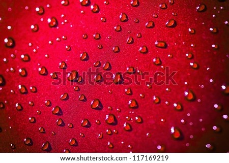 Water drops on abstract red surface. - stock photo