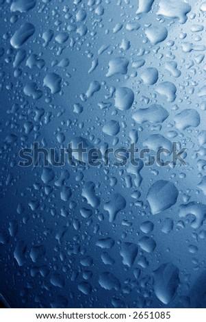 Water drops on Blue Metallic paint - stock photo