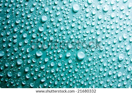 water drops on blue surface - stock photo