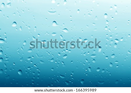 Water drops on clean glass blue background. Ultimate pattern, high resolution.