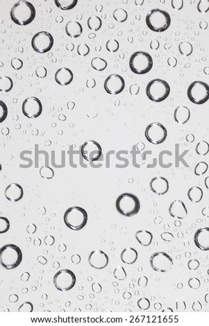 Water drops on clear glass background. - stock photo