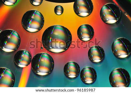 water drops on dvd media - stock photo