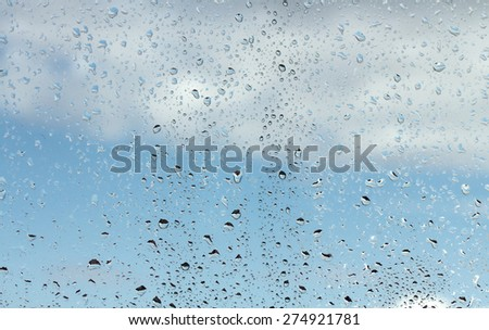 water drops on glass against blue sky