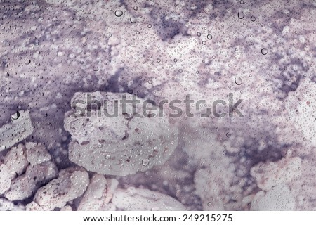 Water drops on glass and defocus nature coral beach background texture at Ao Makam Phuket - stock photo