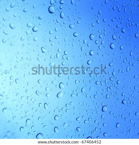 Water drops on glass backgroun - stock photo