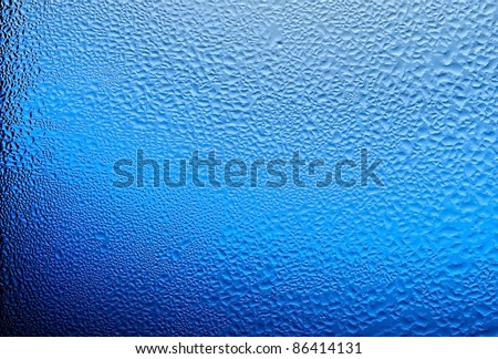 water drops on glass, color blue. - stock photo