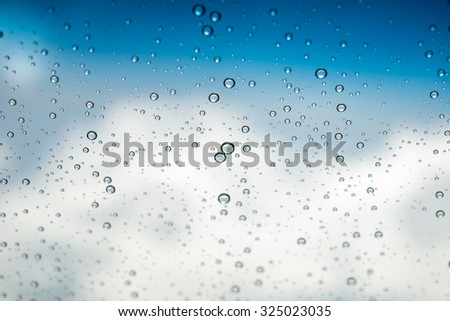 Water drops on glass ,Movement of water drop on glass ,Out of focus water drop movement background for presentation and business - stock photo