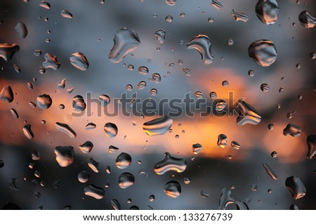 Water drops on glass surface - stock photo