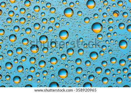 Water drops on glass surface texture.