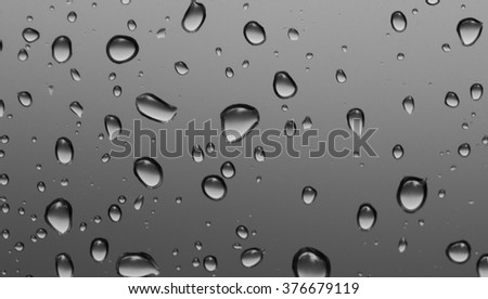Water drops on gray background closeup - stock photo
