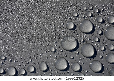 water drops on gray metal surface - stock photo