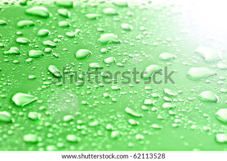 Water drops on green. - stock photo