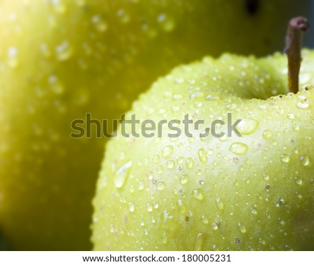 Water drops on healthy green apple - stock photo