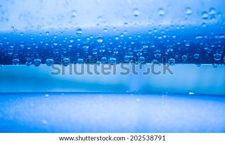 Water drops on heavy metal surface texture in blue tone   - stock photo