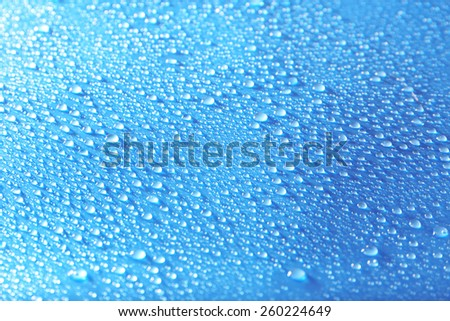 Water drops on light blue background - stock photo