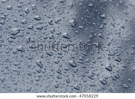 Water drops on metal - stock photo