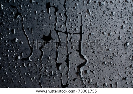 Water drops on metal surface - stock photo