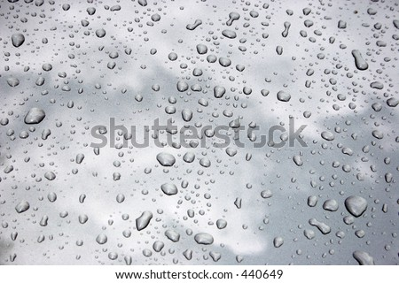Water drops on metalized car paint, hence the tiny grain-looking dots on the surface - stock photo