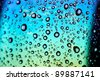 water drops on multicolored surface - stock photo