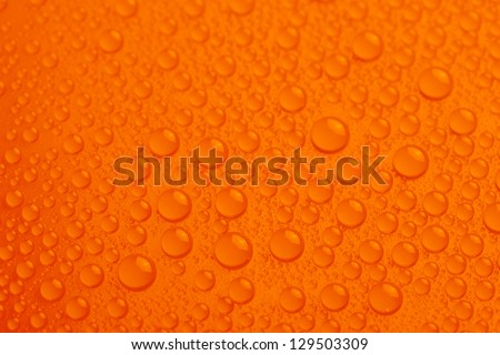 Water drops on orange background - stock photo