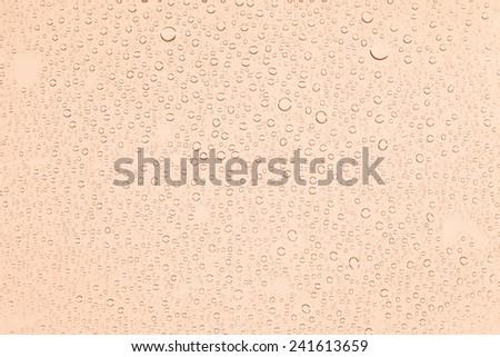 water drops on orange background - stock photo