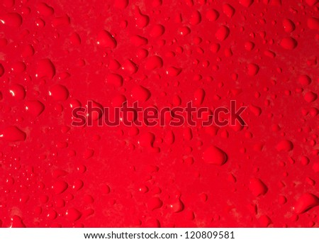 Water drops on red - stock photo
